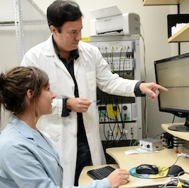 Researchers Justine Renard and Steven Laviolette discuss neuron recording results. Their new study explains how a single marijuana-like drug can have opposite effects at different doses. (Photo credit: Schulich School of Medicine & Dentistry, Western University)