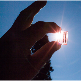 "A small and portable solar cell module constructed with nano-sized gold ""antennae"" that help gather and concentration light, boosting the cell's efficience by up to 10 per cent. (Photo credit: Henry Leparskas)"