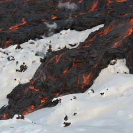 Close-up of a lava lobe moving down onto snowpack during the 2012–13 eruption at Tolbachik volcano in Kamchatka, Russia. (Photo credit: Benjamin R. Edwards)