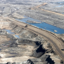 Chemicals released from mines like this oil sands mine in Alberta react with other compounds in the atmosphere to generate harmful pollutants called secondary organic aerosols (Image via Environment and Climate Change Canada)